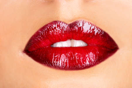 beautiful lips: Macro photo of a red woman LANG_EVOIMAGES
