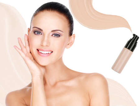 Model face of beautiful smiling woman with foundation on skin make-up cosmetics .   Stock Photo - 23271807