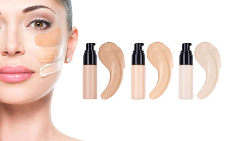 tone: Model face of beautiful woman with foundation on skin make-up cosmetics .   LANG_EVOIMAGES