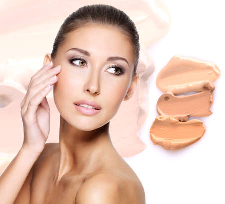 foundation: Model face of beautiful woman with foundation on skin make-up cosmetics .   LANG_EVOIMAGES