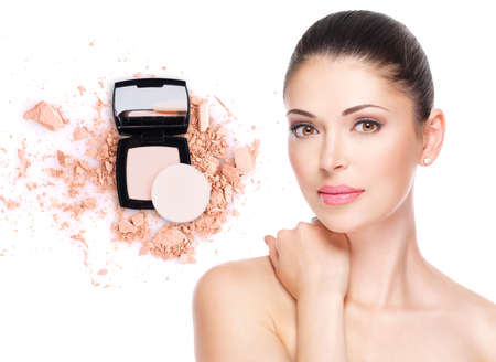 Model face of beautiful woman with foundation on skin make-up cosmetics .   Фото со стока