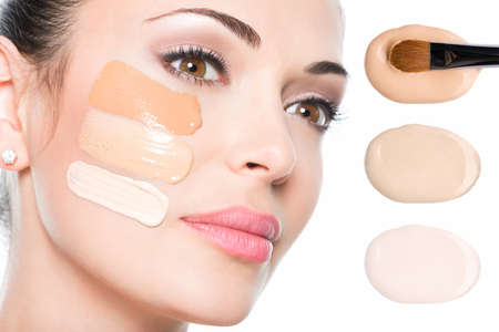 Model face of beautiful woman with foundation on skin make-up cosmetics .   Stok Fotoğraf