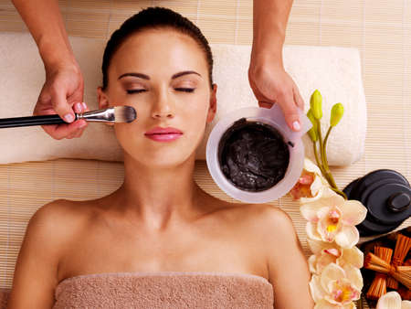 facial spa: Adult woman having beauty treatments  in the spa salon