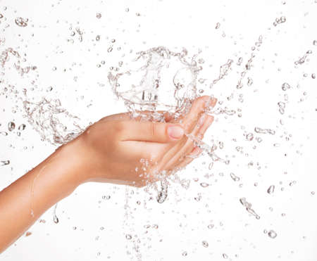 caucasian water drops: Closeup portrait of a beautiful woman washing her clean face with water