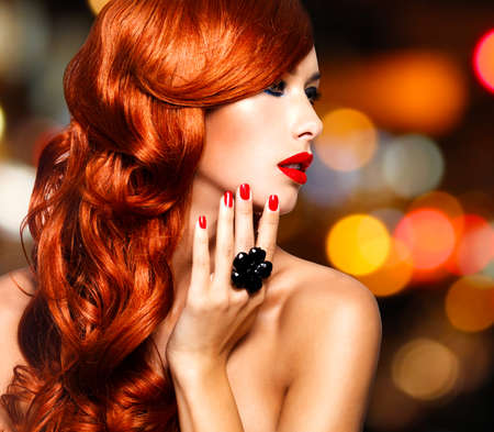 nude art model: Beautiful sensual woman with long red hairs and red nails -   over art blink night lights LANG_EVOIMAGES