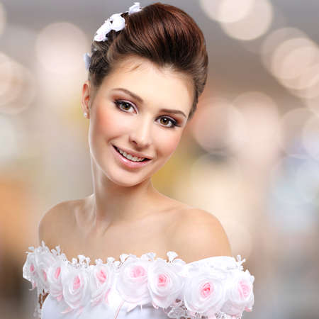 beautiful bride: Portrait of beautiful smiling  bride in wedding dress over art background LANG_EVOIMAGES