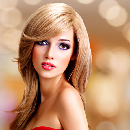 long red hair woman: Closeup portrait of a beautiful young woman with long white hairs. Fashion model posing at studio