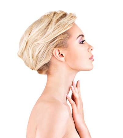 woman neck: Profile face of  young  woman touching neck- isolated on white background