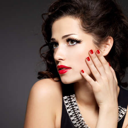 Pretty fashion model with red manicure and lips Stock Photo - 24251188