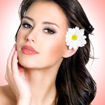 beautiful face: Face of beautiful woman with health skin and  flower over art background