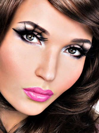 sexy glamour: Beautiful brunette woman with bright fashion eyes and lips make-up LANG_EVOIMAGES