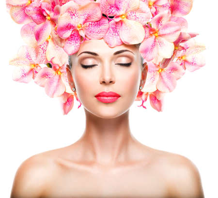 beauty treatment: Relaxed beautiful face of a young girl with clear skin and pink orchids. Beauty treatment concept