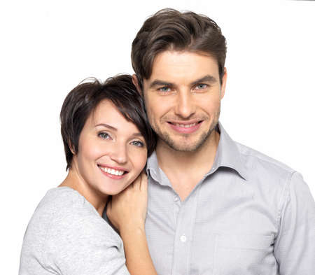 happy couple white background: Closeup portrait of  beautiful happy couple isolated on white background. Attractive man and woman being playful.