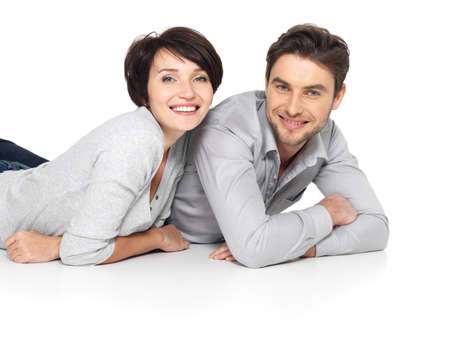 Portrait of happy couple isolated on white background. Attractive man and woman being playful. Stock Photo - 26256351