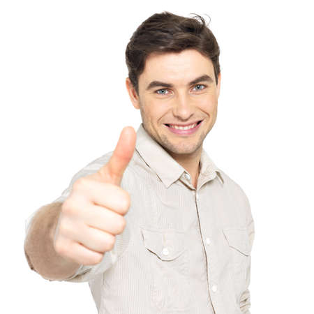 Young happy man with thumbs up sign in  casuals isolated on white background. Stock Photo - 26723624