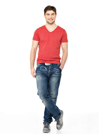 Full portrait of smiling happy handsome man in red t-shirt casuals  isolated on white background. Beautiful young guy posing Stock Photo - 26723625