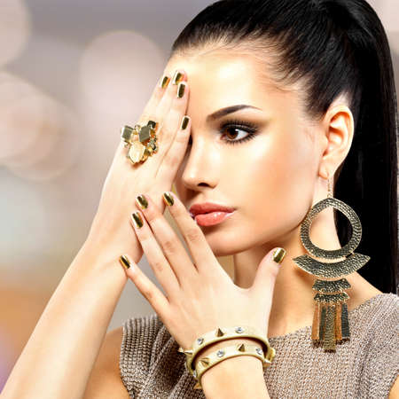 minx: Portrait of the beautiful fashion woman with black makeup and golden manicure LANG_EVOIMAGES