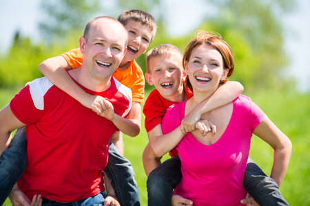 holding family together: Happy family with two children on nature - happiness concept