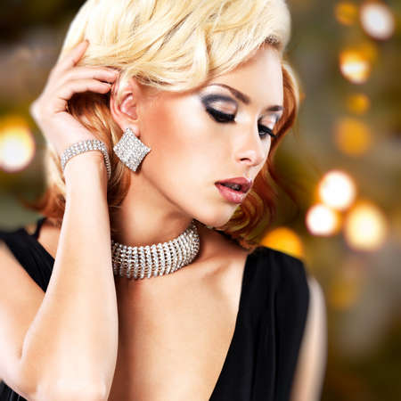 armlet: Portrait of a style beautiful woman over art creative background