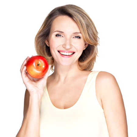 fresh face: Portrait of a young smiling healthy woman with red apple - isolated on white.