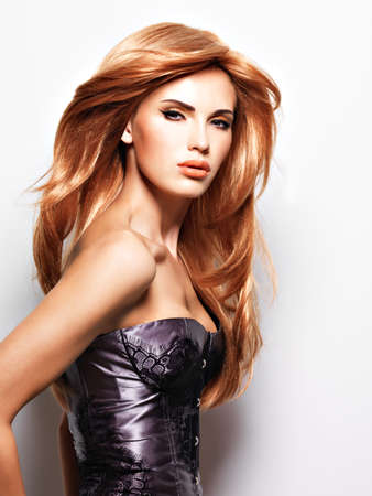 ginger hair: Beautiful woman with long straight red hair. Fashion model over white background LANG_EVOIMAGES