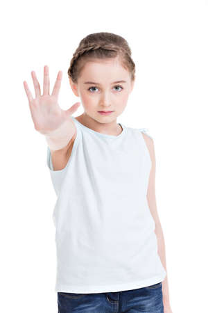 requiring: Pretty little girl requiring stop with her hand - isolated on white.