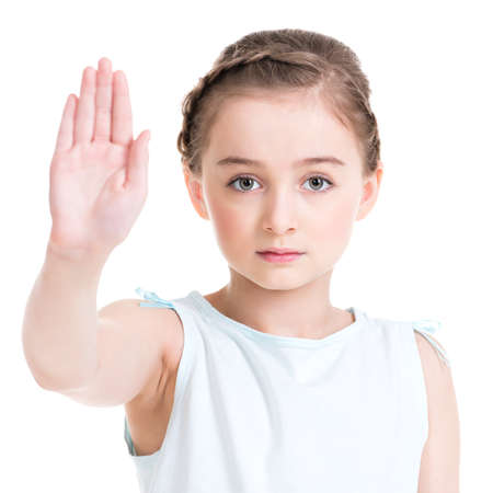stop gesture: Pretty little girl requiring stop with her hand - isolated on white.