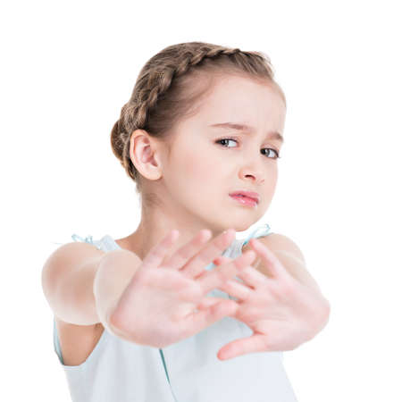 scared girl: Pretty little girl requiring stop with her hand - isolated on white.