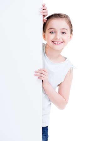 child holding sign: Smiling little girl holding empty white banner - isolated on white.