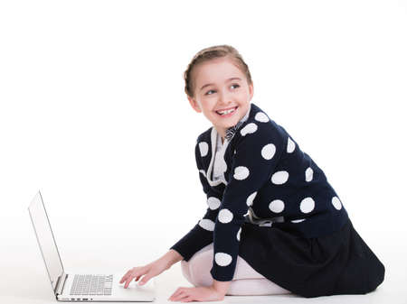 young schoolgirl: Portrait of little girl with silver color laptop -  isolated on white.