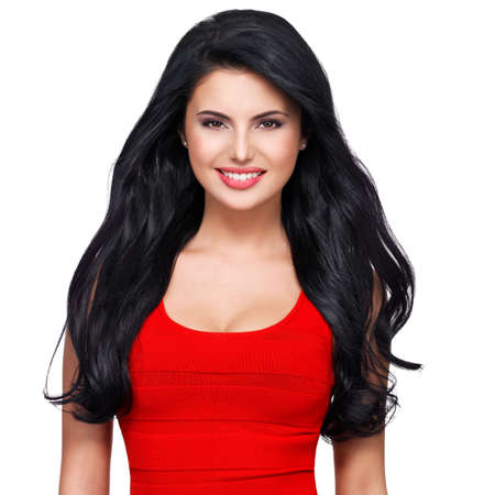 girl in red dress: Portrait of beautiful face of an young smiling woman with long brown hair in red dress
