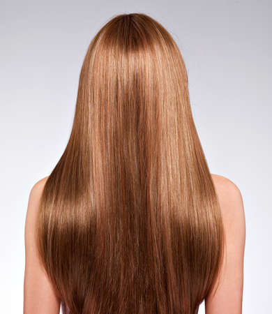 straight hair: Rear view  of the woman with long  hair - studio