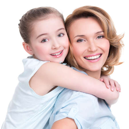 toothy smile: CLoseup portrait of happy  white mother and young daughter - isolated. Happy family people concept.