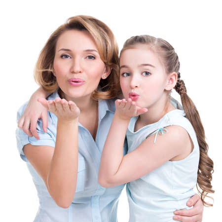 Portrait of mother and daughter send kisses - studio shot on white Stock Photo - 26256823
