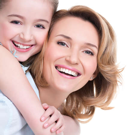 CLoseup portrait of happy  white mother and young daughter - isolated. Happy family people concept. Stock Photo - 26256837