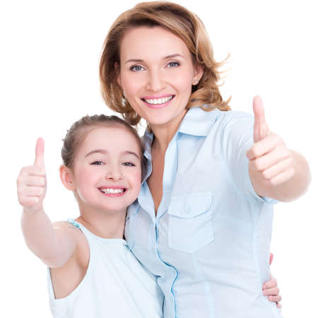 thumbs up gesture: Portrait of happy  white mother and young daughter with thumbs up - isolated. Happy family people concept.