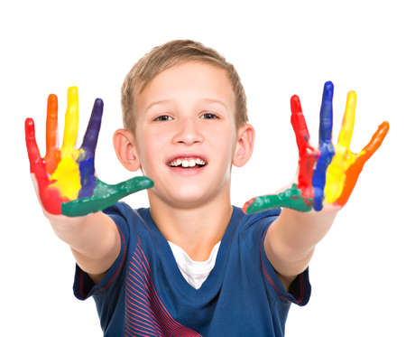 kids painted hands: Happy smiling Boy with a painted hands - isolated on white. LANG_EVOIMAGES