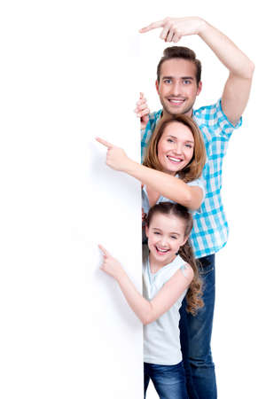 four fingers: Portrait of an american family pointing by finger to the banner - isolated on a white background LANG_EVOIMAGES