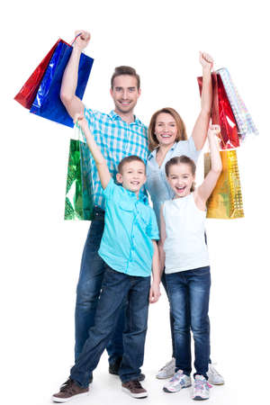 Happy american family with children holding shopping bags - over white background LANG_EVOIMAGES