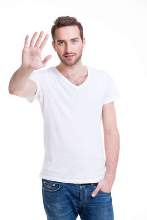 requiring: Young handsome man requiring stop with his hand - isolated on white.