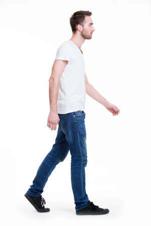 man profile: Full portrait of walking man in white t-shirt casuals - isolated on white.