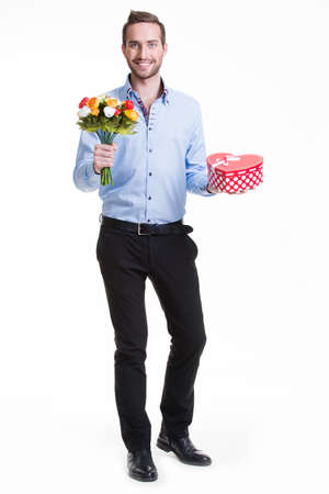 flower boxes: Portrait of happy young man with flowers and a gift -  isolated on white.