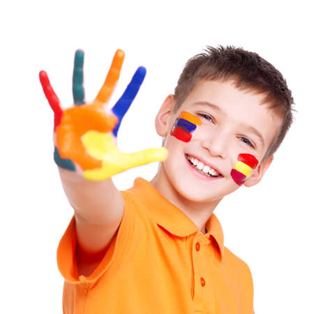kids painted hands: Happy smiling boy with a painted hand and face in orange t-shirt - on a white background.