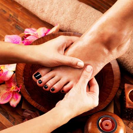 foot massage: Massage of woman LANG_EVOIMAGES