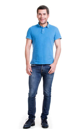 blue jeans: Full portrait of smiling happy handsome man in blue jeans standing isolated on white background.