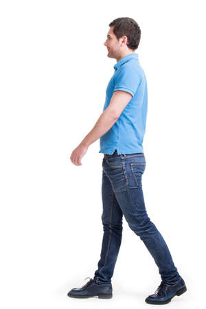 Full portrait of smiling walking man in red t-shirt casuals - isolated on white. photo
