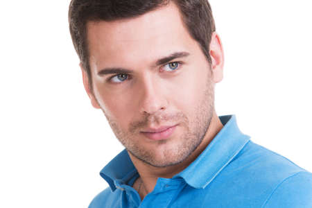 sideways: Closeup portrait of  handsome man in blue shirt - isolated on white.  Stock Photo