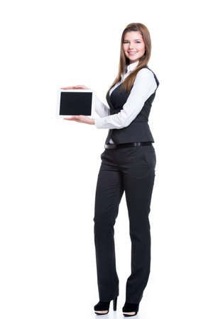 Portrait of  beautiful young happy business woman holding tablet  with blank screen in full length - isolated on white. photo