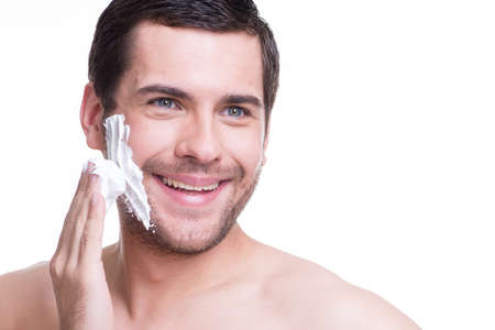 sexy handsome young man with a shaving foam photo