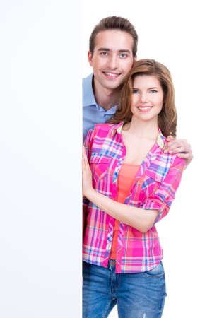 Portrait of beautiful happy couple with banner isolated on white background. photo